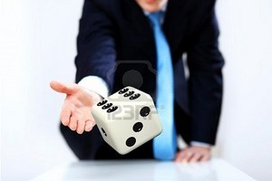 12561262-image-of-a-flying-dice-as-symbol-of-risk-and-luck.jpg